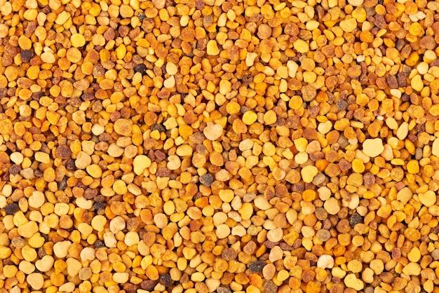Priorità bassa dei grani di polline del fiore. pila di polline d'api o perga. Foto Premium