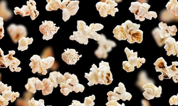 Popcorn volanti sul nero Foto Premium