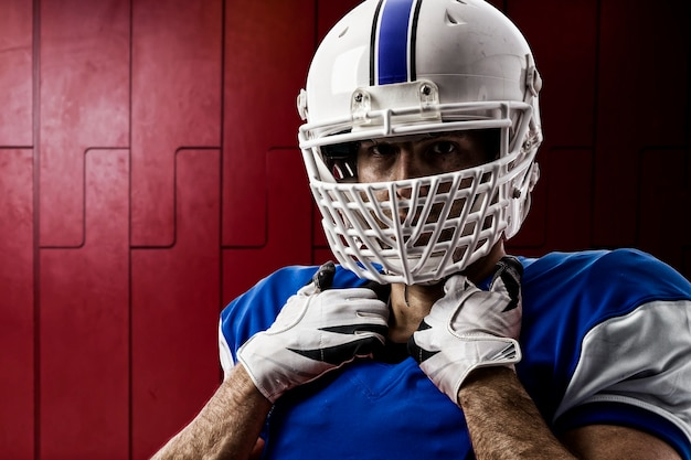 Giocatore di football con una divisa blu su un armadietto Foto Premium