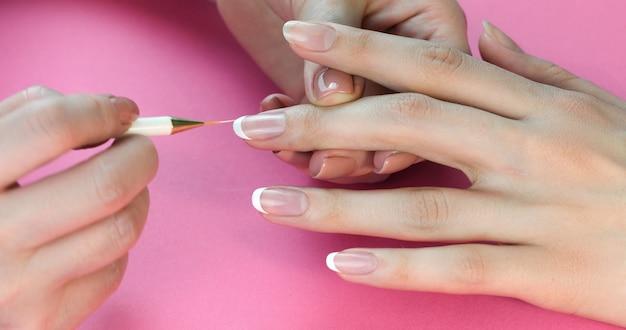 Pittura unghie francese Foto Premium