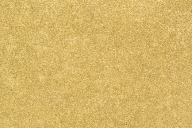 Texture di carta oro. sfondo astratto di lamina d'oro opaco liscio. avvicinamento. Foto Premium
