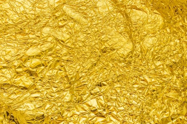 Foglio di alluminio dorato sfondo, vista dall'alto Foto Premium