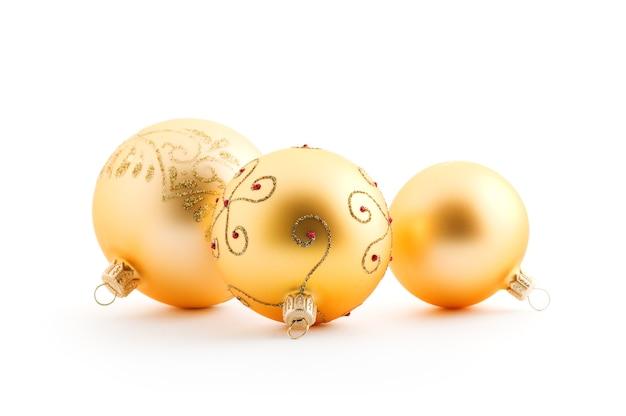 Palle di natale dorate su bianco Foto Premium