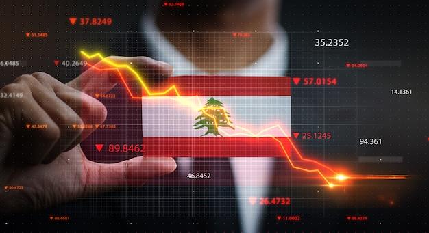Grafico che cade davanti alla bandiera del libano. concetto di crisi Foto Premium