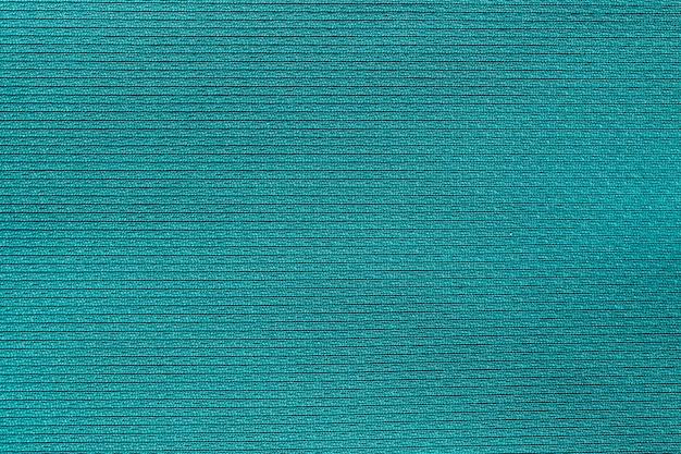 Priorità bassa di struttura del poliestere panno tessuto verde. Foto Premium