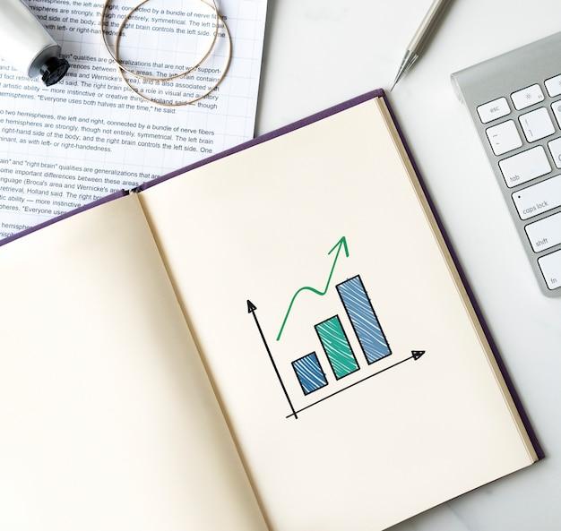 Grafico a barre crescente su un notebook Foto Premium