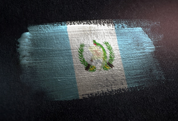 Bandiera del guatemala fatta di vernice spazzola metallica sulla parete scura del grunge Foto Premium