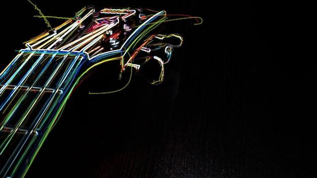 Paletta per chitarra. pittura al neon di colore astratto. Foto Premium