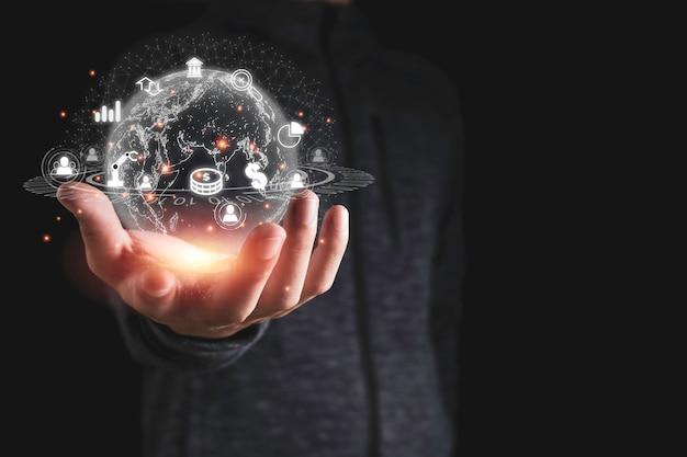 Passi la tenuta della rete globale virtuale con le icone di affari come il simbolo di dollaro del grafico. la trasformazione degli investimenti aziendali mediante l'uso di analisi di intelligenza artificiale è importante. Foto Premium