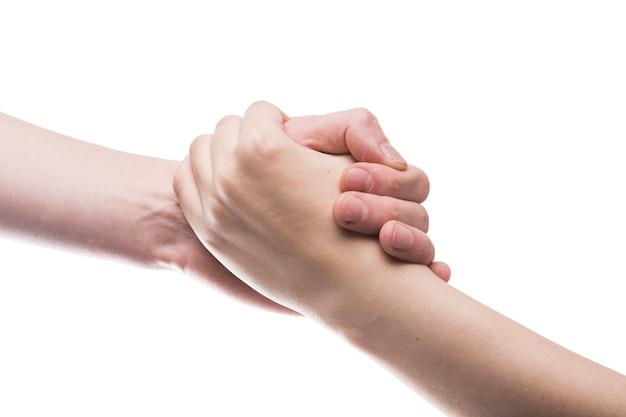 Mani che si stringono l'un l'altro Foto Premium
