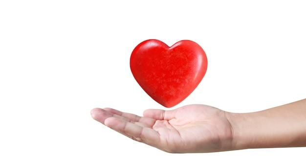 Mani che tengono un cuore rosso. la salute del cuore. e concetti di donazione Foto Premium