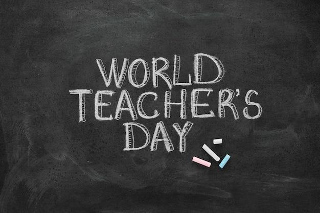 Iscrizione di gesso di concetto di giorno dell'insegnante felice Foto Premium