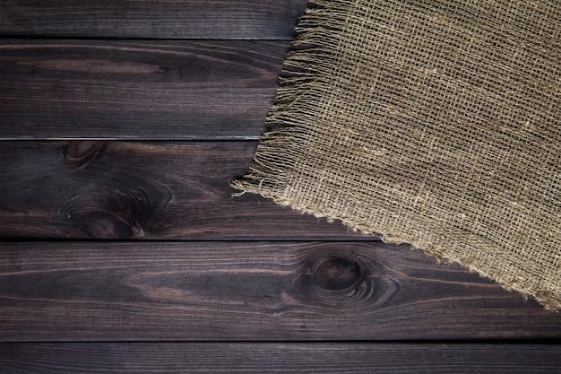 Struttura della tela di iuta sulla tavola di legno Foto Premium