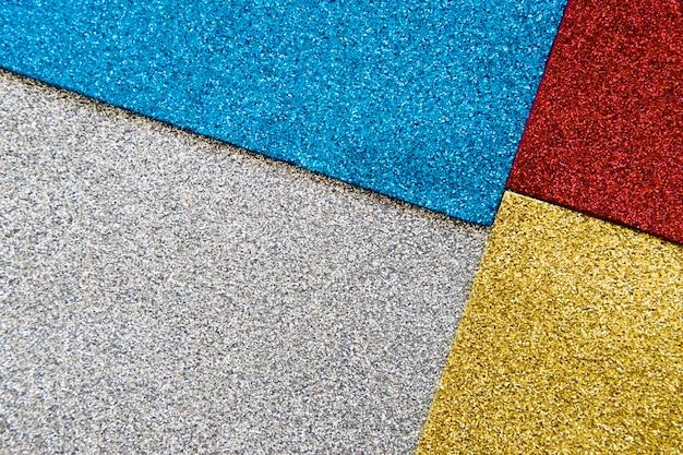 Vista dell'angolo alto di multi fondo colorato di struttura di scintillio Foto Premium