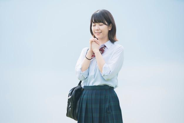 Preghiera della ragazza del liceo Foto Premium