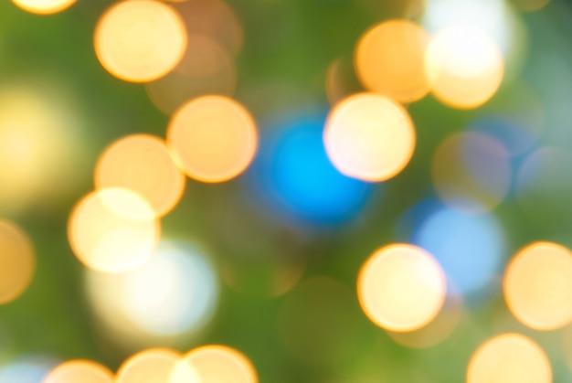 Fondo morbido di natale delle luci blu, gialle e verdi di festa Foto Premium