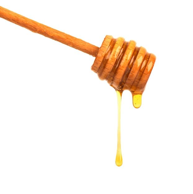Sgocciolatura del miele isolata su spazio bianco. miele isolato Foto Premium