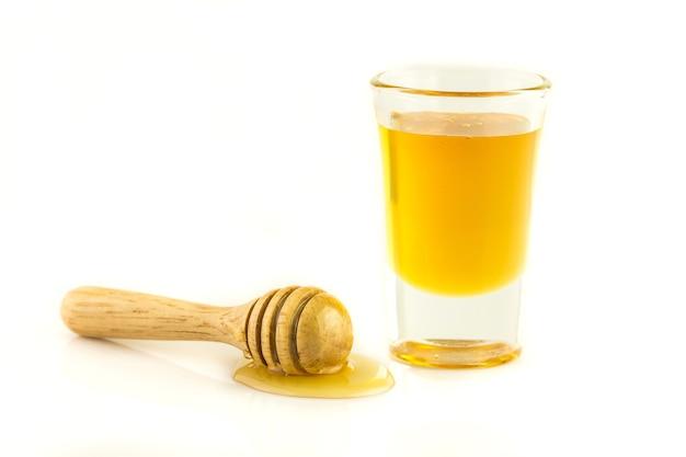 Miele con legno isolato Foto Premium