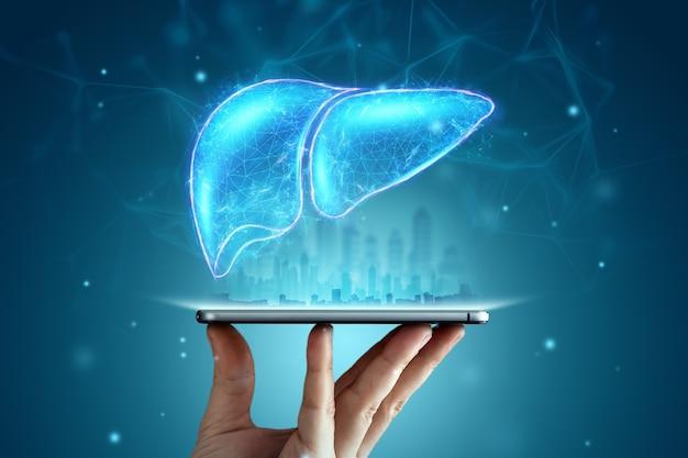 Immagine di un ologramma di fegato su uno smartphone su sfondo blu. concetto di affari di trattamento dell'epatite umana, prevenzione delle malattie, diagnosi online. Foto Premium