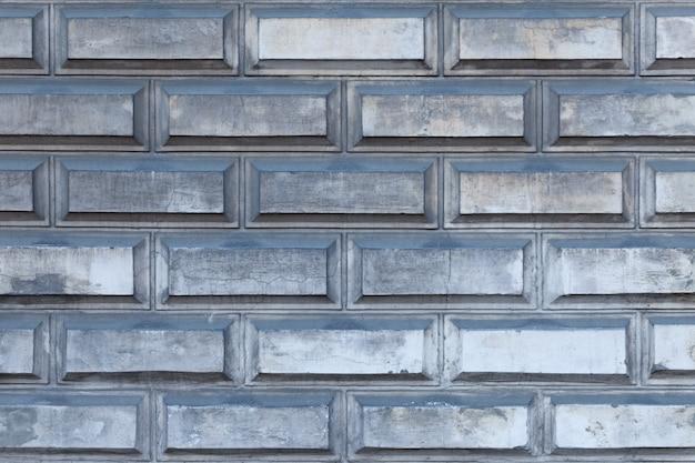 Fondo orizzontale del muro di mattoni grigio industriale Foto Premium