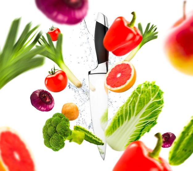 Coltello e verdure fresche Foto Premium