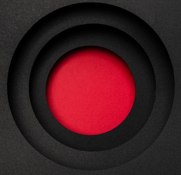 Strati di sfondo nero circolare e cerchio rosso Foto Premium