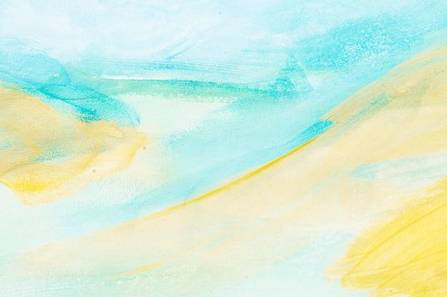 Contesto strutturato astratto di pennellata blu-chiaro e giallo Foto Premium