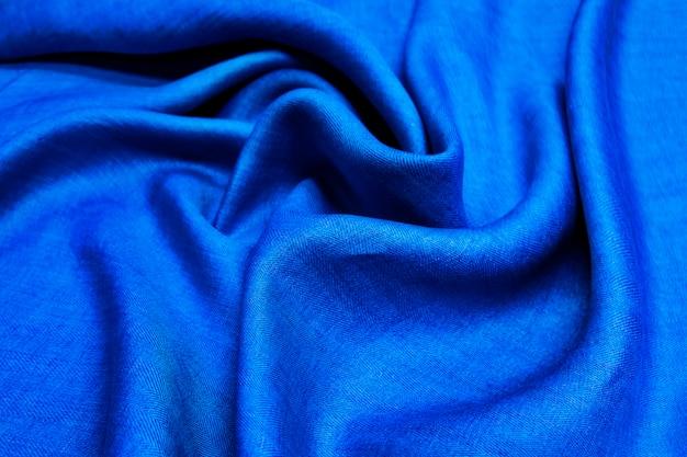Sfondo blu denim tessuto di lino. trama di tessuto blu lino morbido rugoso. Foto Premium