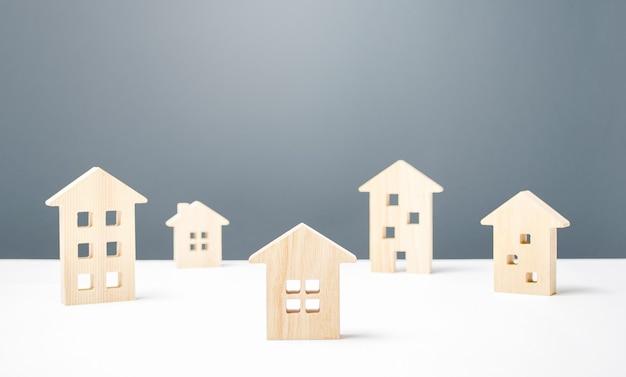 Molte figure in legno di edifici residenziali alloggi confortevoli a prezzi accessibili studi urbani e scienza buon quartiere moderno Foto Premium