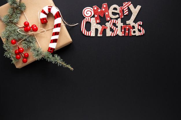 Segno di buon natale con regalo Foto Premium