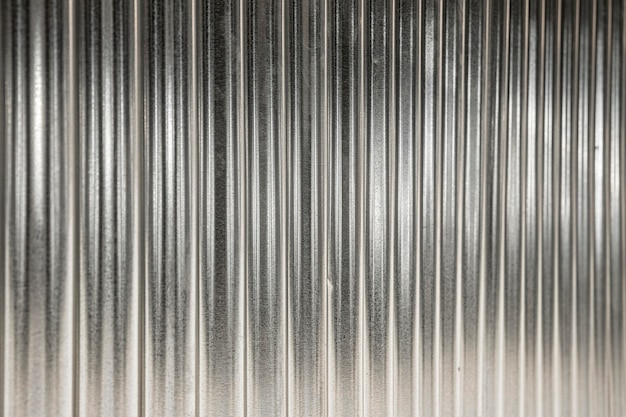 Sfondo metallico con linee verticali d'argento Foto Premium