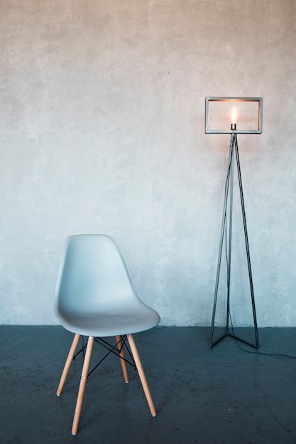 Interior design minimalista con una sedia Foto Premium