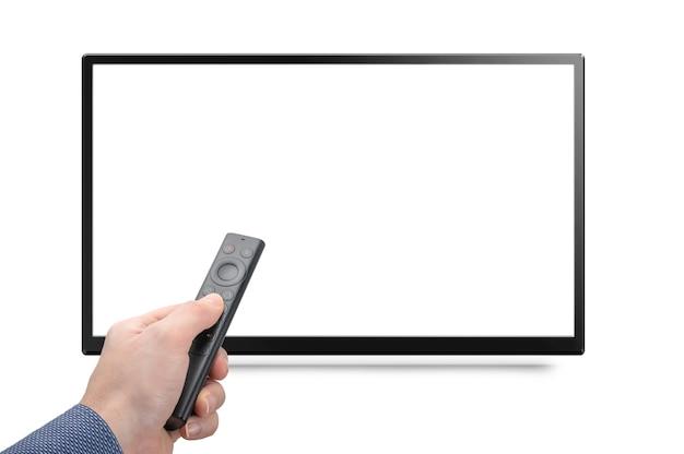 Mockup tv e mano con moderno telecomando da un media box online isolato su sfondo bianco. tv 4k 8k con telecomando in mano mock up. mock-up monitor schermo vuoto bianco Foto Premium