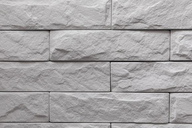 Priorità bassa di struttura del muro di mattoni bianchi moderni Foto Premium