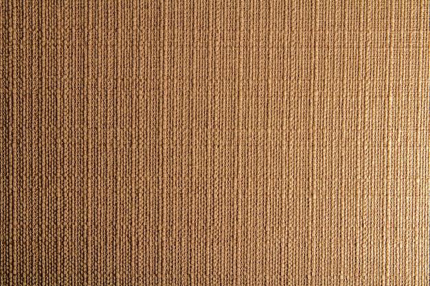 Design in tessuto di lino naturale. tela vestita. sfondo di tela marrone. cotone. Foto Premium