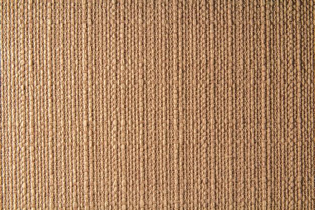 Trama di lino in tessuto naturale per il design, tela strutturata. sfondo di tela marrone. cotone. Foto Premium