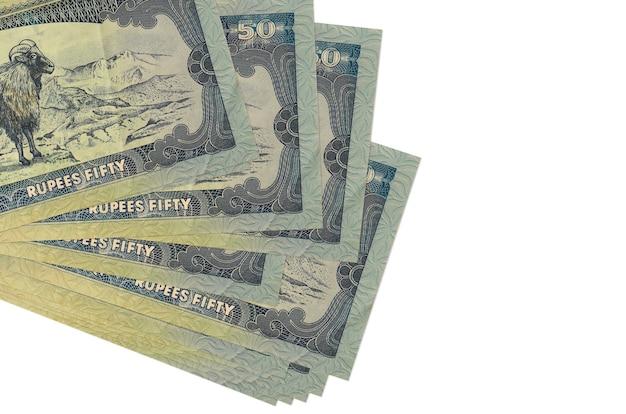 Le fatture della rupia nepalese si trovano in piccolo mazzo o pacchetto isolato su bianco Foto Premium