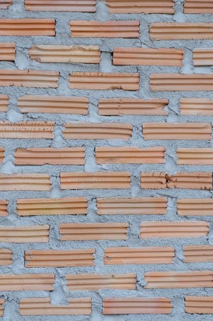 Nuovo muro di mattoni per lo sfondo Foto Premium