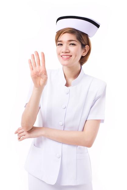 Infermiera che indica 4 dita verso l'alto Foto Premium