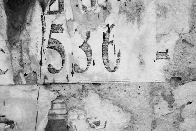 I vecchi manifesti di lerciume incartano il fondo di superficie di struttura Foto Premium