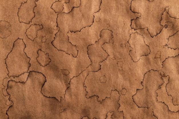Vecchia struttura kraft, sfondo di carta antica con macchie di caffè marroni Foto Premium
