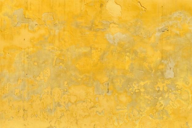 Vecchio sfondo vintage ricoperto di vernice gialla Foto Premium