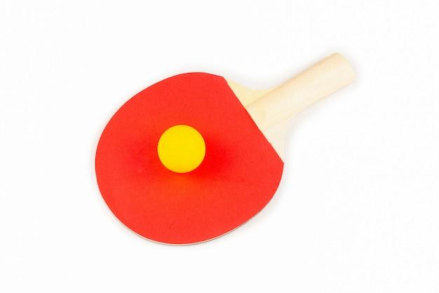 Pin pong su uno sfondo arancione. vista dall'alto. Foto Premium