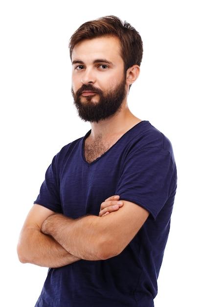 Ritratto di un giovane uomo barbuto isolato su bianco Foto Premium