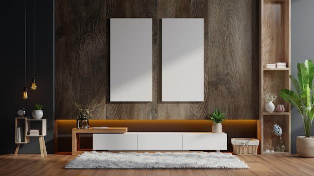 Poster con cornici verticali sulla parete in legno scuro vuoto all'interno del soggiorno con armadio Foto Premium