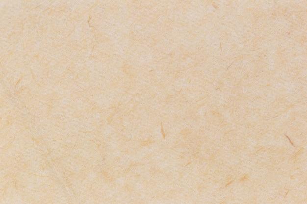 Priorità bassa di struttura di carta riciclata o superficie del cartone dalla scatola di carta per il disegno grafico. Foto Premium