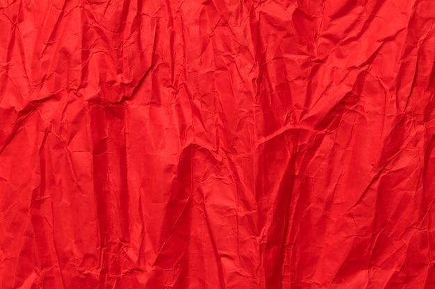 Struttura di carta sgualcita rossa, priorità bassa del grunge Foto Premium
