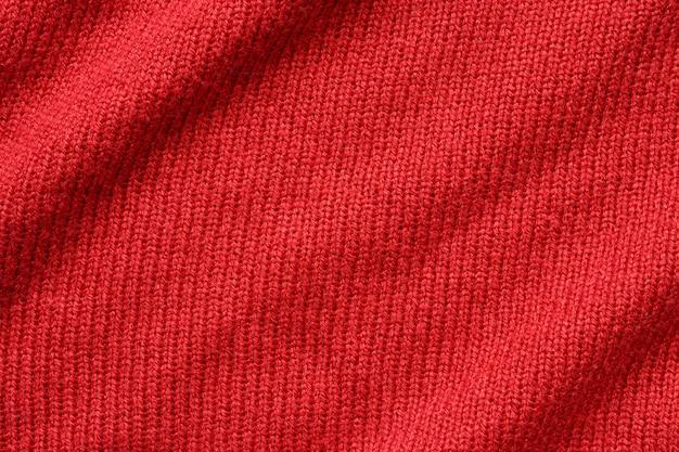 Priorità bassa di struttura di lana lavorata a maglia rossa Foto Premium