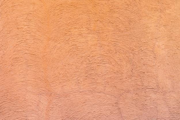Colore rosso - arancio sul cemento astratto della curva di struttura casuale sul muro al pomeriggio. Foto Premium