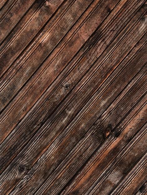 Fondo strutturato di legno marrone scuro ruvido Foto Premium